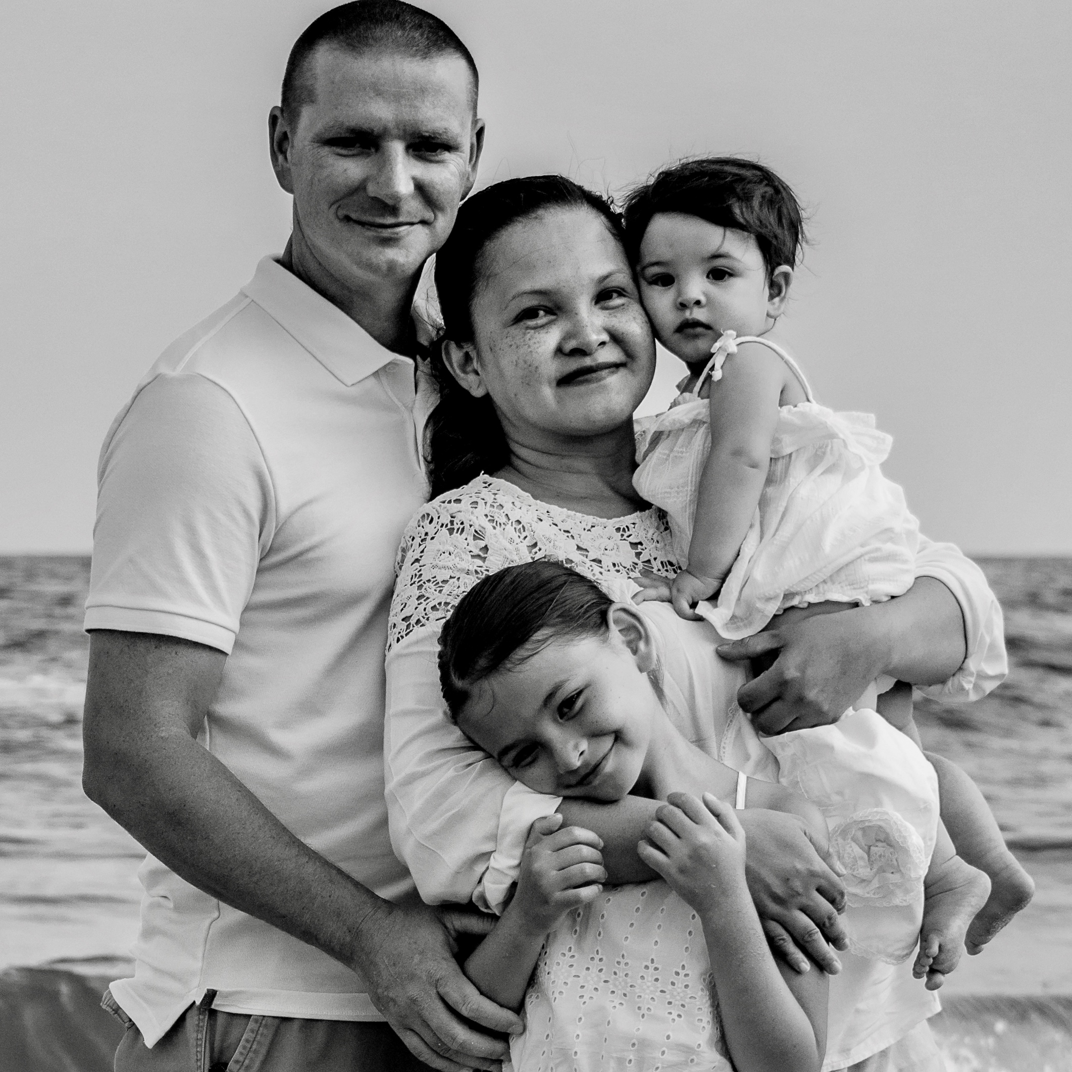 Maria-Teresa King pictured with her husband and two daughters on a beach. King completed her degree in Health Services Administration from UL Lafayette.