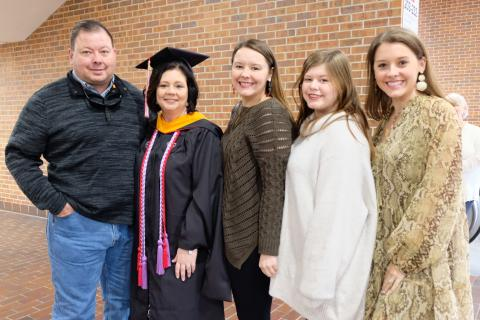 Tina Billberry, Outstanding Master's Graduate, with her family.