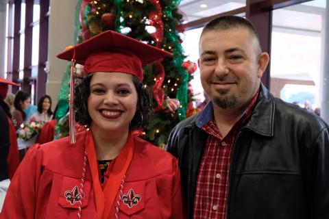 Miranda Wiles Domec with her husband Scott following UL Lafayette graduation.